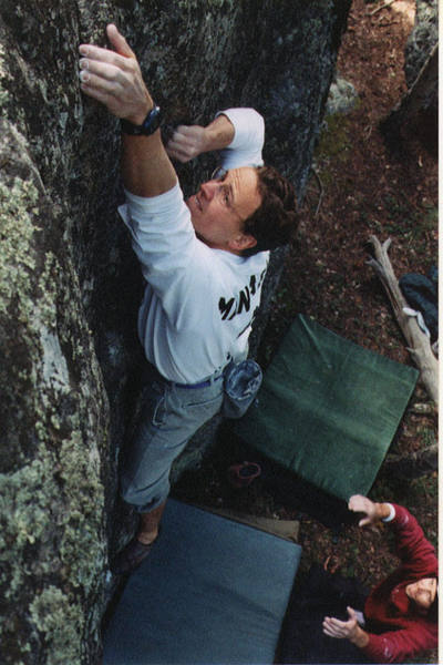 Here's Dave at the top of his <br> problem, Seul Avec Dieux, <br> pretending that his right hand is on a <br> hold. <br> Photo by Violetta Asscherick.