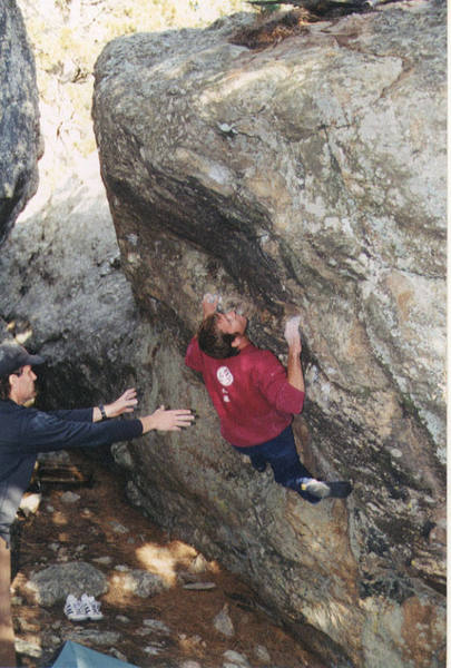 This is me setting up for the crux <br> move on Sit Down and Be Counted, <br> a problem that some people think is <br> the hardest problem at Baldy <br> (besides the Prow)!<br> I'm being spotted by Brent Kertzman <br> and the photo was taken by David <br> Asscherick.