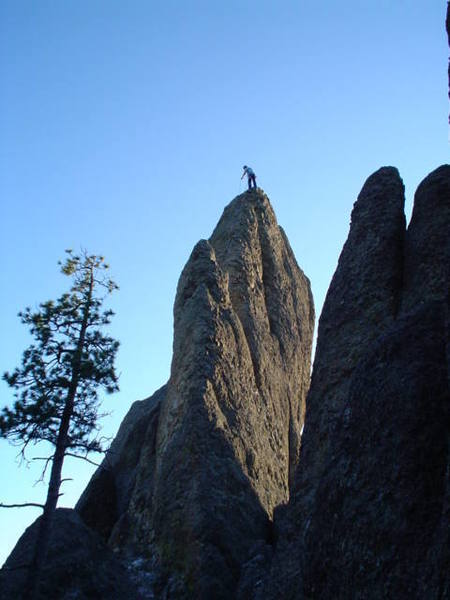 This is taken after walking through the notch to the right of the tunnel.  The climb starts on the lower left of the picture to the right of the tree you see.  This is a picture of the Moonlight Rib with a climber on top getting ready to rappel.