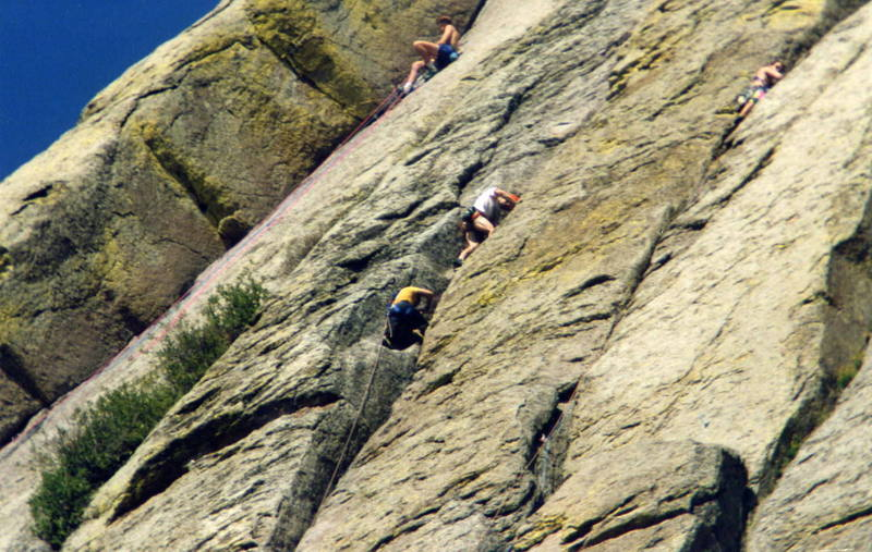 Busy day on the east face.  From left to right, The first belay on Soler, the vegetated morass of Todtmoos, cramped belay on Tad and climber nearing the belay ledge of El Cracko.
