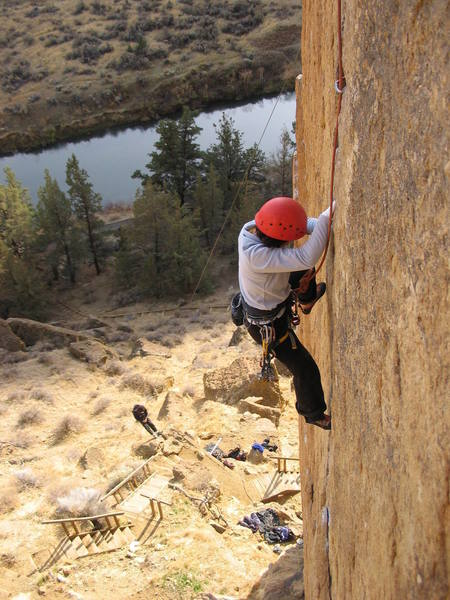 My wife following Karate Crack.  Photo taken from bolt anchors atop the route (inside chimney).