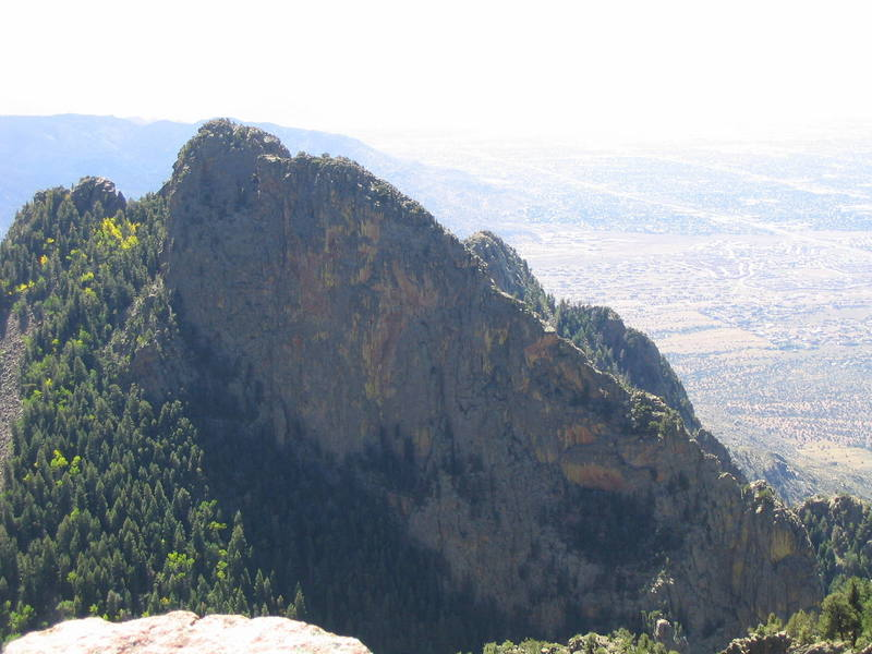 Photo of The Thumb from the limestone band that surrounds the summit of the Sandia Crest.