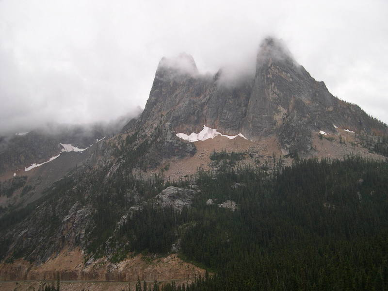Washington Pass shrouded in clouds, a little unusual for August. The Early Winter Spires are on the left and Liberty Bell is the rightmost peak. (Photo thanks to Matt Farmer)