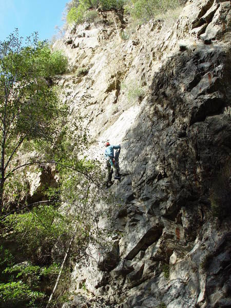Perin Blanchard just before the crux on <em>South of the Trout Farm</em>. Photo by Ashley Blanchard.