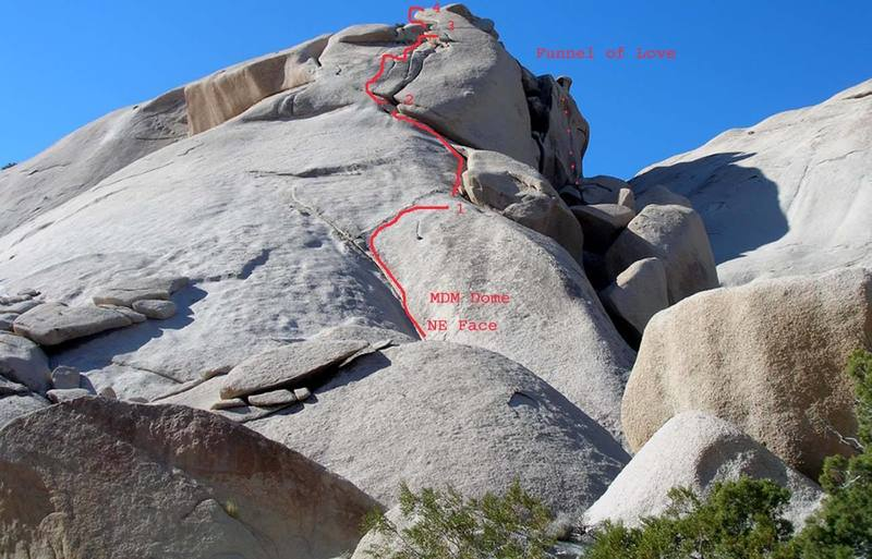 East face of Saddleback Dome NE route and Funnel of Love on north face.  Approaching Funnel from this side is slabby 4th class between house-sized boulders.  Approach from west face is a zig zag up to saddle then hop down to route.  Latter is easier approach @ 30-45 min.