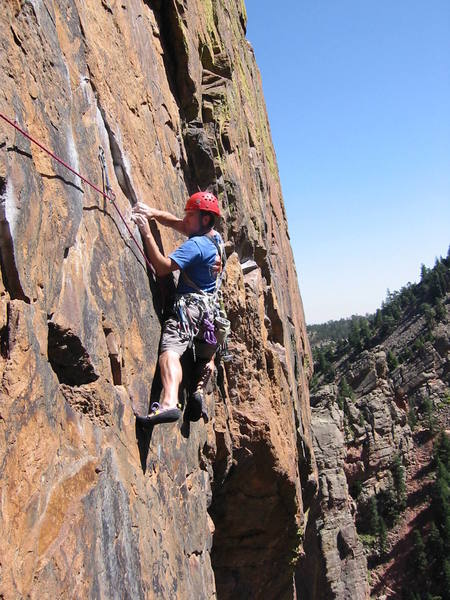 The key to stepping across on Rosy Crucifixion, step low and use the lower handhold. 5.10
