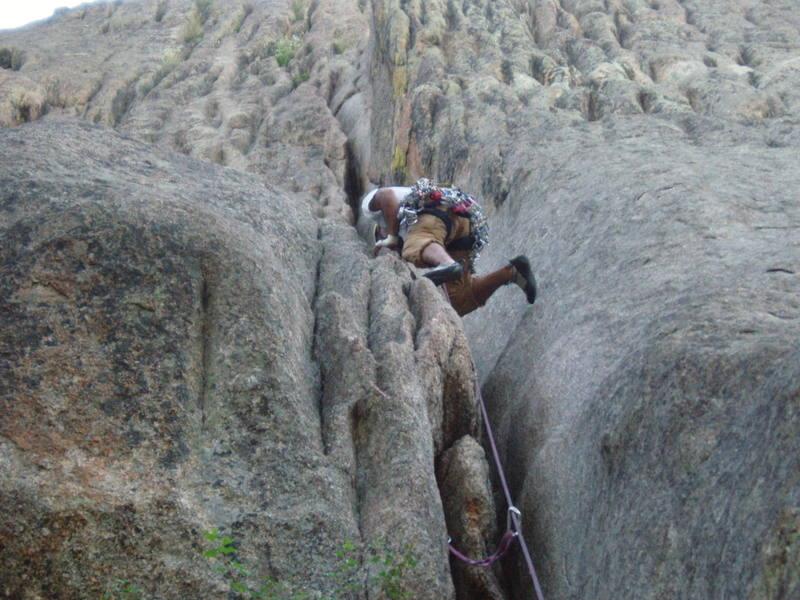 Ahad Sabet pulling through the awkward section of the 1st pitch on Osiris, Lumpy Ridge, CO.