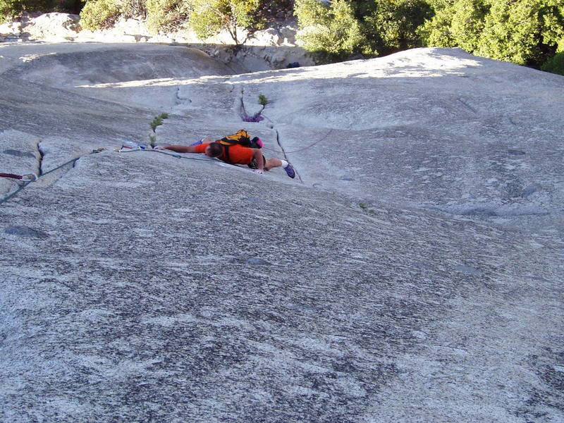 Paul is making the crux move switching cracks on the 10a P2 of Serenity Crack.