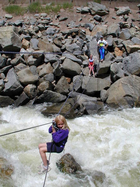 The tyrolean traverse across Boulder Creek.  Gaelyn Crowder, age 7, putting a brave face on it.