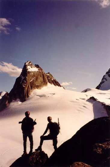 Tony and Fred pause on the descent of the Kain Route, Bugaboo Spire. Pigeon Spire in back.