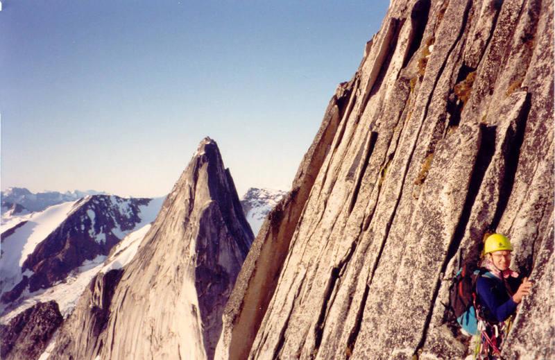 Fred Batliner on the NE Ridge of Bugaboo Spire - Snowpatch Spire behind.