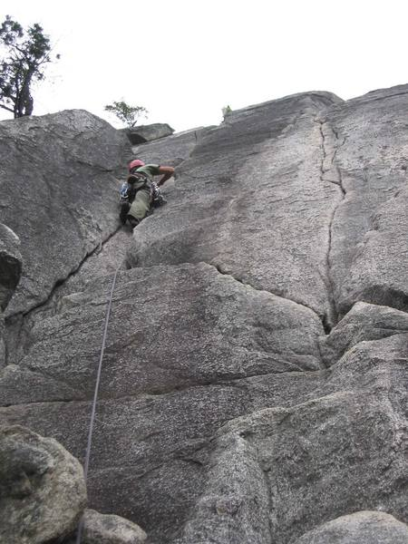 Climbing the Corner Crack (5.7+) at the Smoke Bluffs.