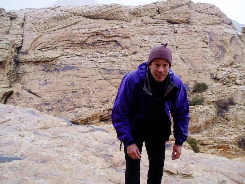 Retreating from the top of a climb in Red Rocks, NV in the Rain at the Sandstone Quarry area. Image by Chris Parks, 3/2006.