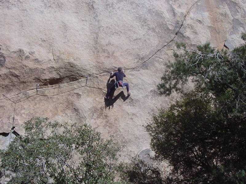 Bobby P. moving through the sustained crux section on the first pitch.