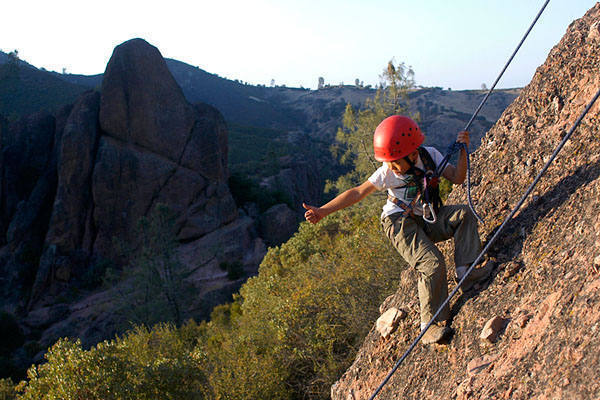 Nine-year-old Billy Louie triumphantly signals his belayer on the First Sister.