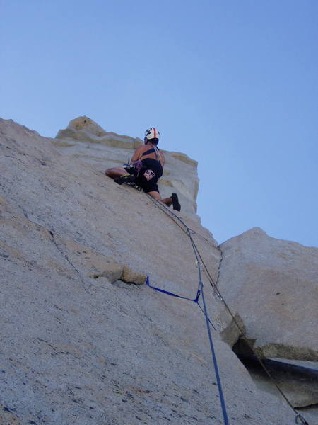 Calvin Kilcrease leading above the 10a finger crack on P.4.