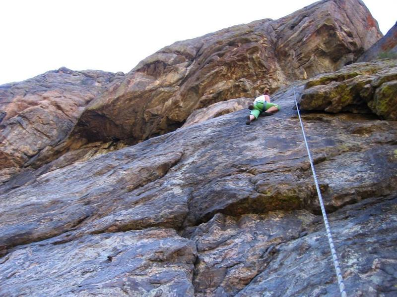 Minda working through the upper part of the crux.  The People's Choice dihedral (P3) can be seen directly above.