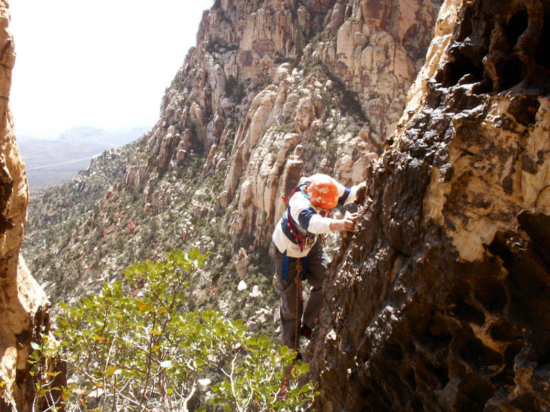 Larry climbs the picturesque 5th pitch arete during the FA while sporting the latest in swami attire.