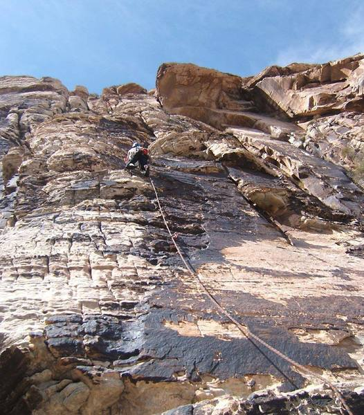 Face-climbing on the first pitch of Sunburn.  The route works up to the left side of the huge roof above.