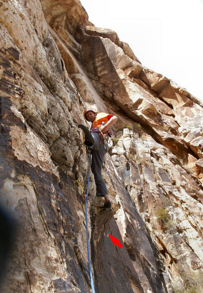Larry firing in pro at crux of 2nd pitch.  Notice a bolt of unknown origin indicated on the face to the right of the route.