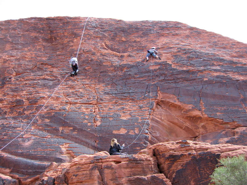 Climbers on Neon Sunset (left) and Technicolor Sunrise (right).  Zipperhead starts on the thin crack between these routes.