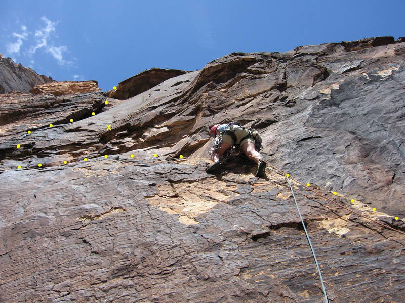 Sharon Vinick on the fun ramp at the start of P3.  The crux traverse left past a bolt lies above, followed by a steep, airy corner.