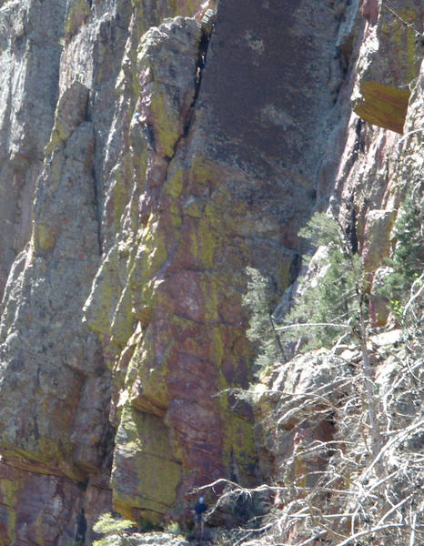 Sherrie, in blue helmet, going for the last bolt on Angel Wing's first pitch.  She's at the bottom of the leaning tower.  Doug is just visible on the ledge wearing a blue helmet, also.  The more you stay on the overhang, the easier it is.