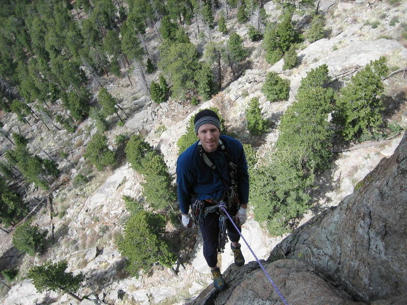 Taking a break while re-racking for the link up of pitches 4 and 5 of TurnKorner on Sundance Buttress, Lumpy Ridge.