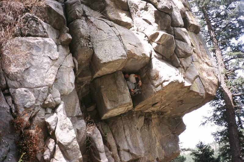 Tony finds a good rest before the crux while leading Spectre (10d), in Boulder Canyon, Colorado. Image by Rachel Rice, 2006.