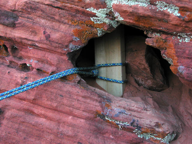 Photo of the namesake 2x4 used as one of our three natural anchors for rapping in to bolt the line.