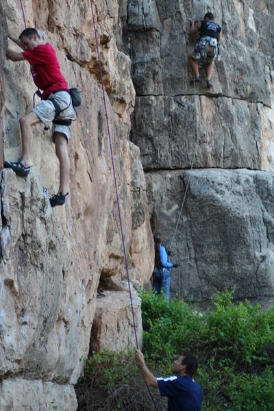 """Brian on Fist Full of Dollars (Black Shirt)and right by the second bolt on the arete and just below the crux.  The fun stuff lies above!!  Bro Jason is on """"Mickey Goes to Vegas"""" a very fun 5.9."""