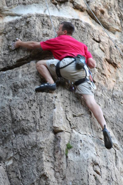 Bro Jason TR'ing and just past the crux moves and searching for that next hold