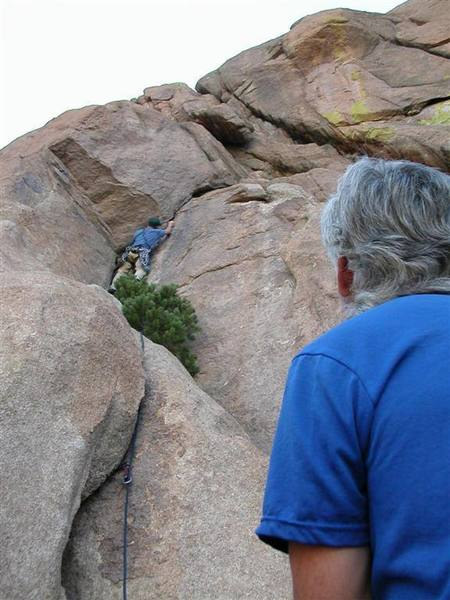 Climber on the first pitch of Dustdevils