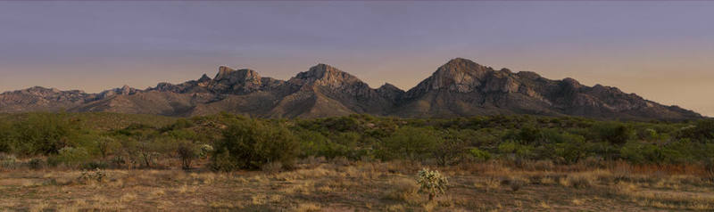 Panorama of the north side of the Santa Catalina mountains at sunset.  Visible climbing areas include Pusch Peak, Table Mountain, and the Domes above Catalina State Park.  Mt. Lemmon proper sits beyond the left edge of this photo.