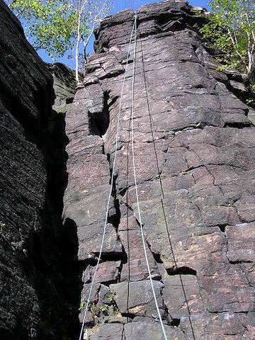 The Thinker (5.7) is the crack system on the left side of the face.  The Dreamer (5.10b) goes directly up the center of the face.
