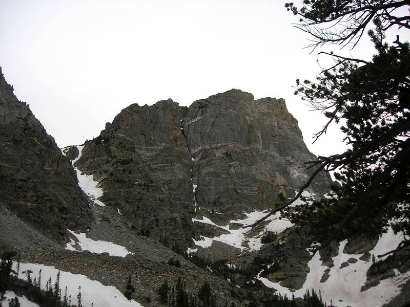 Beta Photo of Hallett Chimney: The route follows the thin band of snow in the chimney running up the middle of the face.
