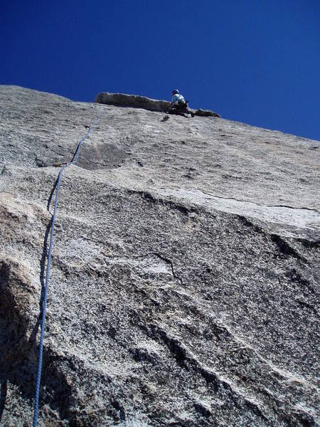 It's quite a ways from the last bolt when you finally reach the corner.  And of course the hardest, thinnest, scariest moves are right at the end!