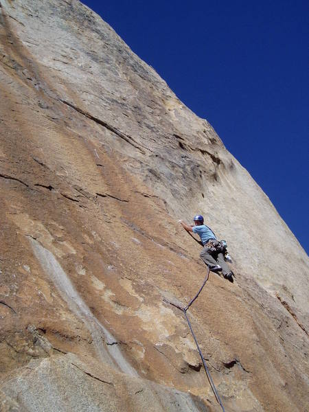 Glad to get to larger holds, Paul looks back at 1st crux.  Many more to go!
