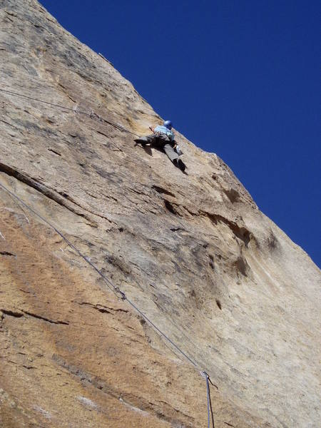 Paul feeling out the moves of the traverse.  The belay stance can be seen on the skyline right of Paul's head.  It's still a long ways to go. Although Paul's position is probably the right way to start the traverse, Paul got suckered into the low traverse which got pretty intense towards the end!
