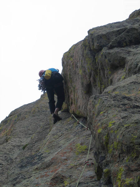 It's getting harder here and the end has some surprises. I won't spoil for you, but it does not quite end as I expected. Your partners have a nice big comfy ledge to watch you work the crux and take pictures. (Photo by John Courtney)