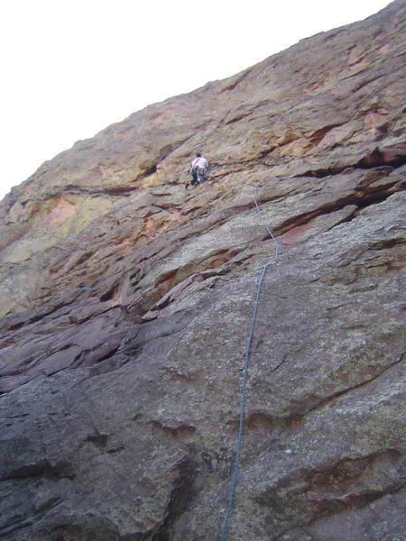 Moving up the band towards the first belay. The crux of this pitch is the first 20 feet of unprotected 5.8ish slab climbing.