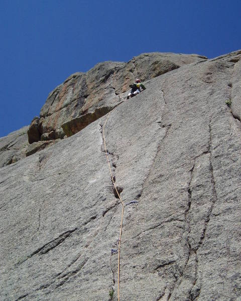 Done. An easy slab with a crack leads to the belay below the second pitch of Outlander.