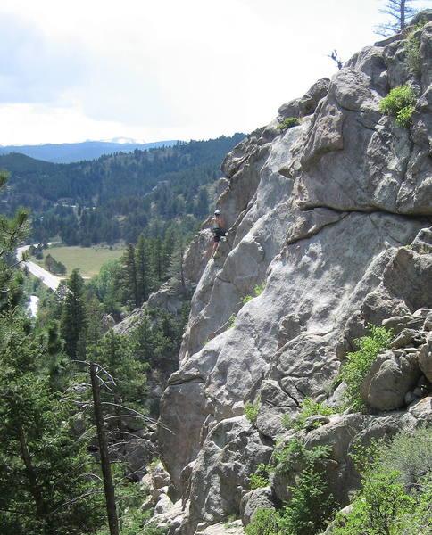 Climber on Surprising Crag, enjoying the view.