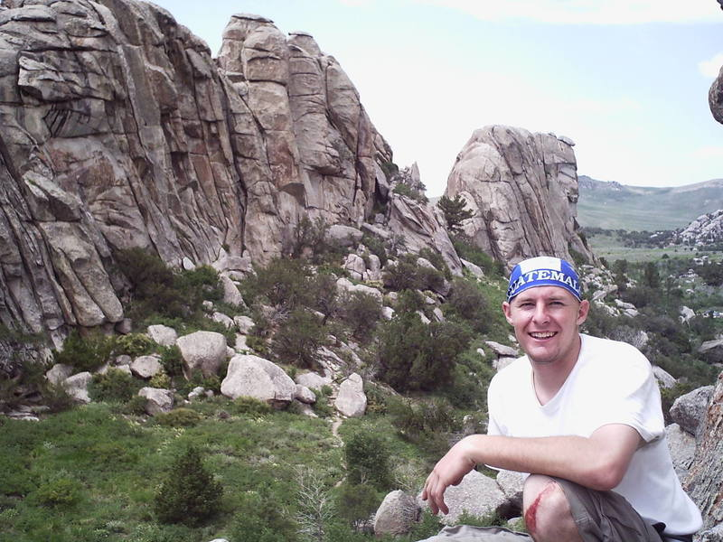 Todd on top of Owl Rock, with the Breadloaves in the background.