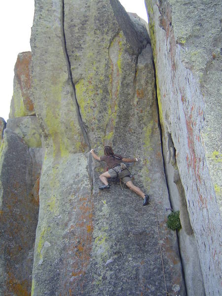 Chris Garner, leading off on the beautiful 5.11 overhanging Hand Crack on the N. Side of the Upper Breadloaves