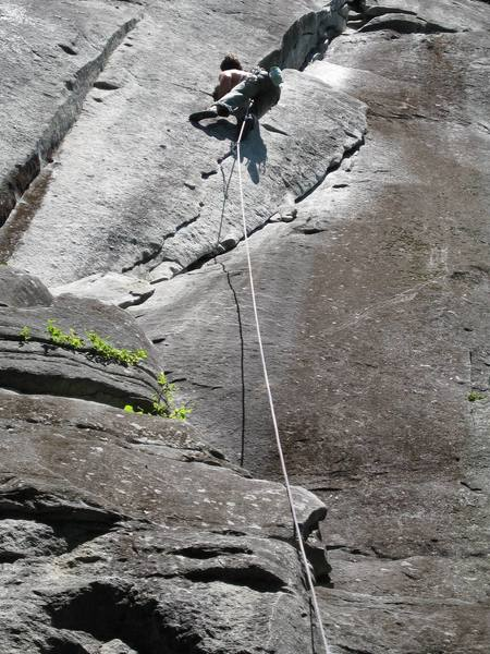Unknown climber doing the 10a middle variation to Godzilla P1.  The standard route cruises up and around the right side of the flake.