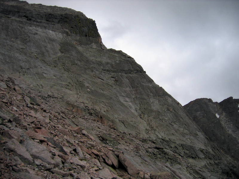 """The North Buttress of Pagoda as seen from the east.  The """"vertical tower"""" can be seen in the top of the photo -the crux 4th pitch starts up the left side of the gold colored rock on this skyline prow. The dark band that the route starts above can be seen in the bottom right hand side. The bottom 3 pitches stay on this side of the buttress as they ascend the corners just left of the skyline ridge. Classic!"""