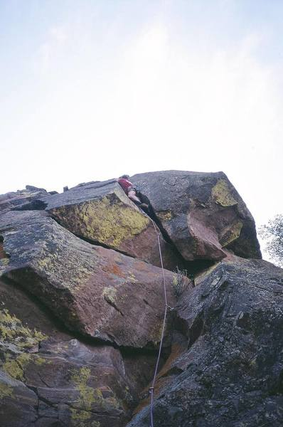 Tony Bubb leads just above the wide crux of On-Slot (5.11b) at Continental Crag, in Eldorado Canyon. Photo by Jason Haas.