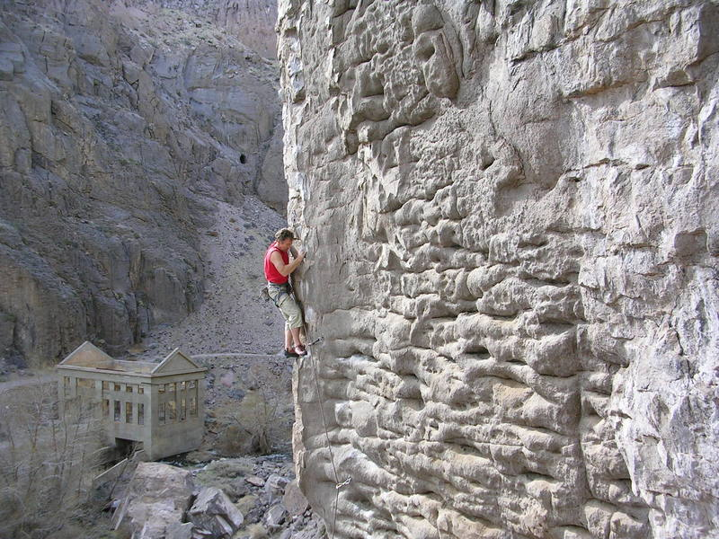 Red-pointing in the Owens River Gorge at Solarium. The ruins-of-Mordor ambiance and occasional self-chalking slopers might deter some.  But the view of the Sierra from up at the cars makes up for the gloominess.  And the awesome quantity of great routes on bullet-hard, pocketed, basalt places the Gorge a cut above all other western sport areas, (except maybe Smith Rock).  Thank you first-ascensioneers!