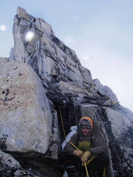 Seth Hobby belaying me (just visible further up) on Claw Peak in full-on conditions.  Photo courtesy of Tom Gray.